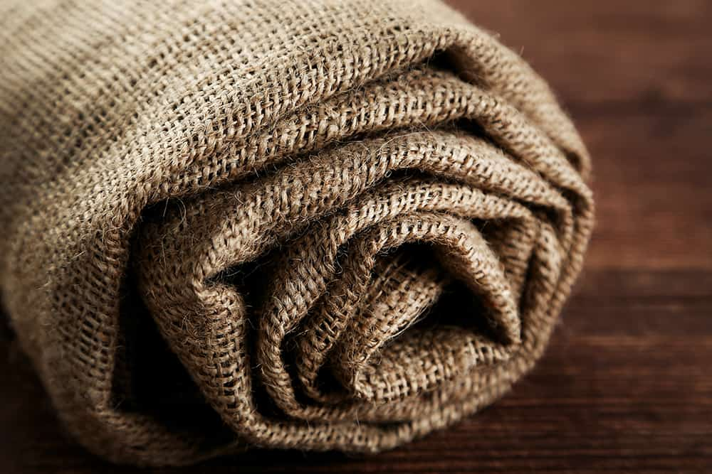 Rolled up burlap sheets