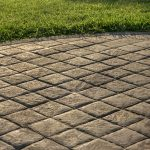 Does sealing pavers prevent weeds