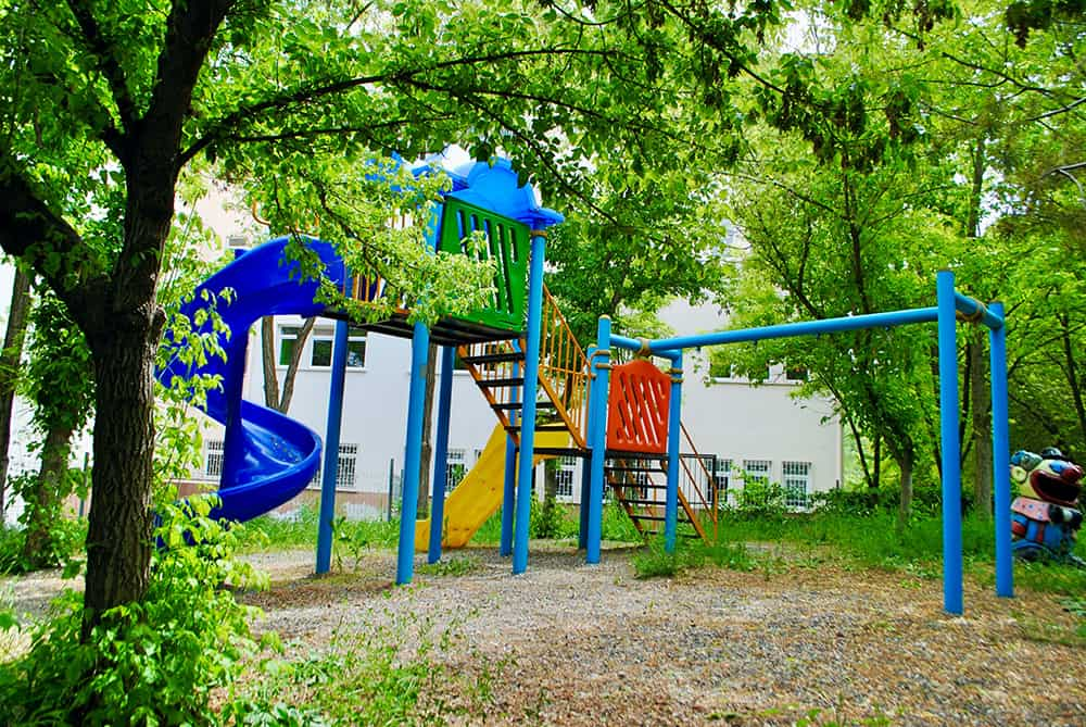 A playground cleared of weeds using child-safe methods