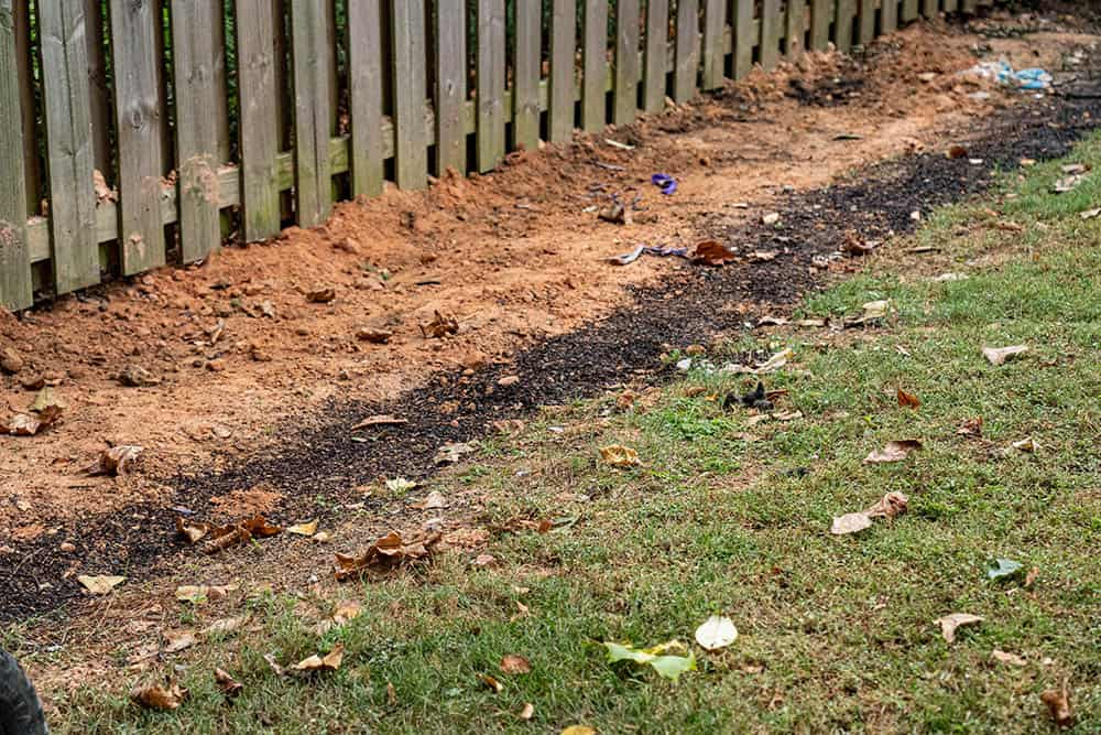 Dirt and soil covering a french drain
