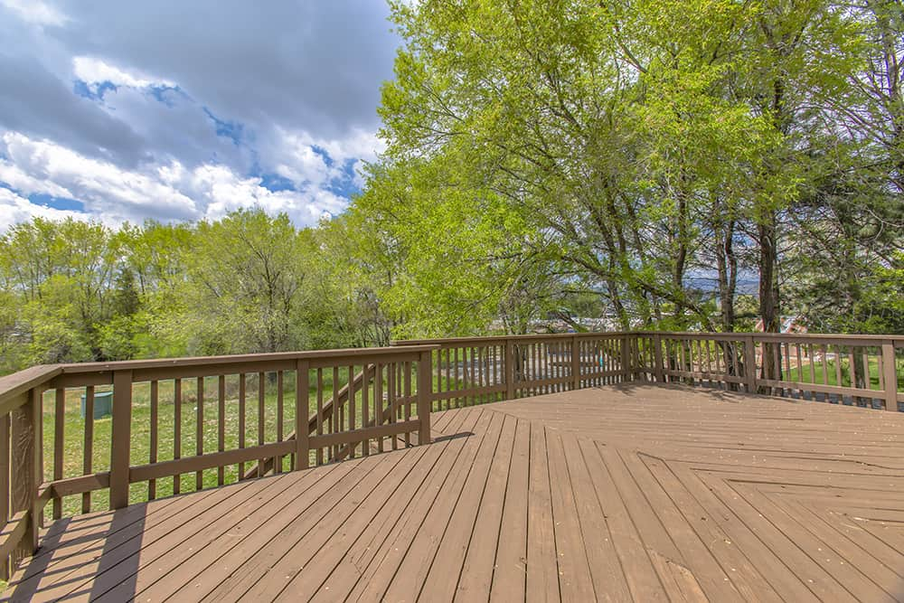 What to put under deck to prevent weeds