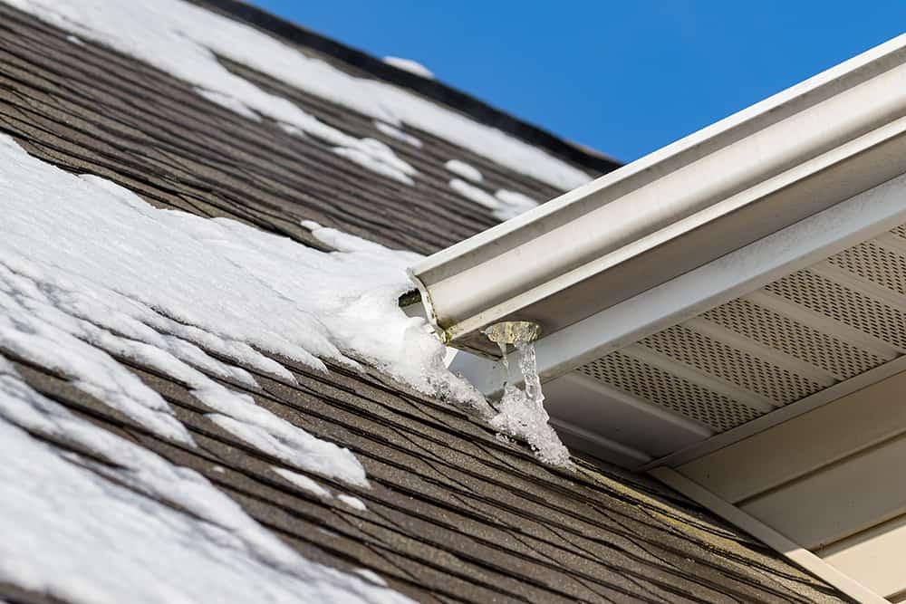 Frozen gutters in the winter