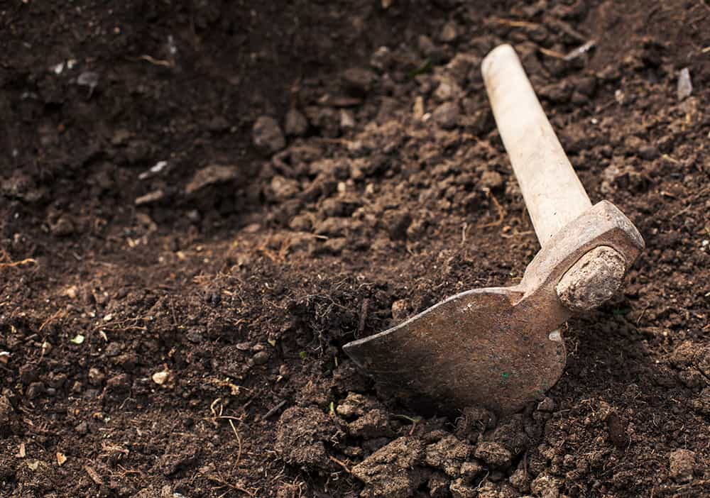 Use a hoe when digging a trench by hand