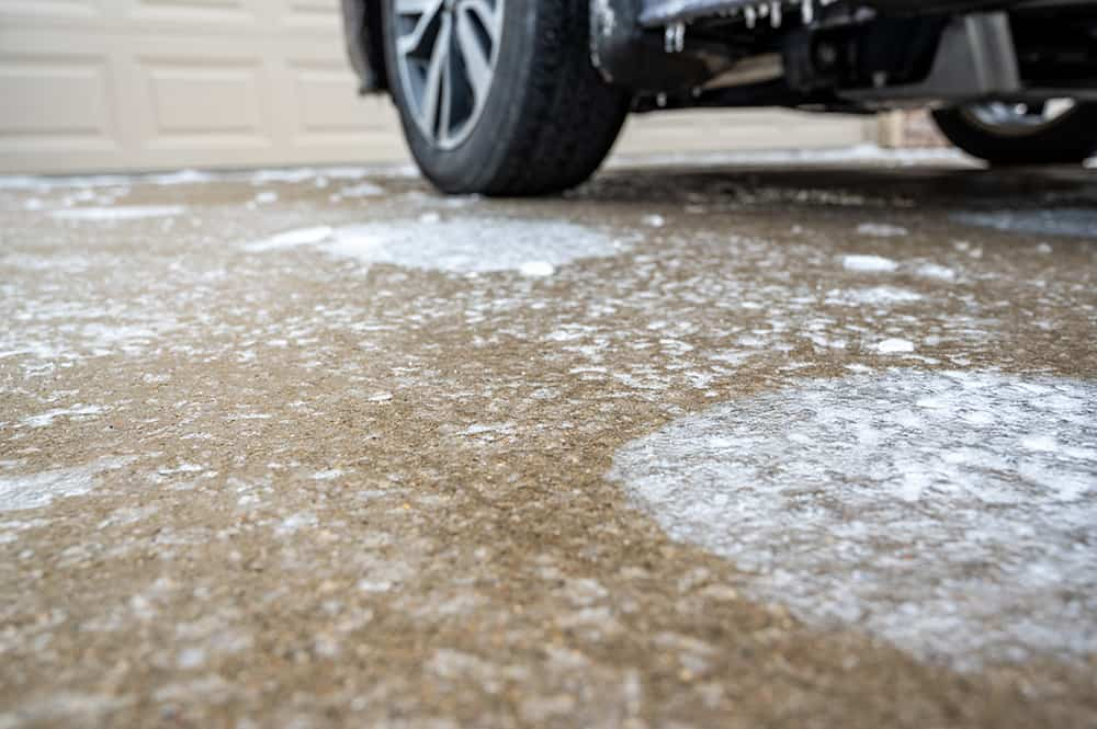 How to melt ice on concrete
