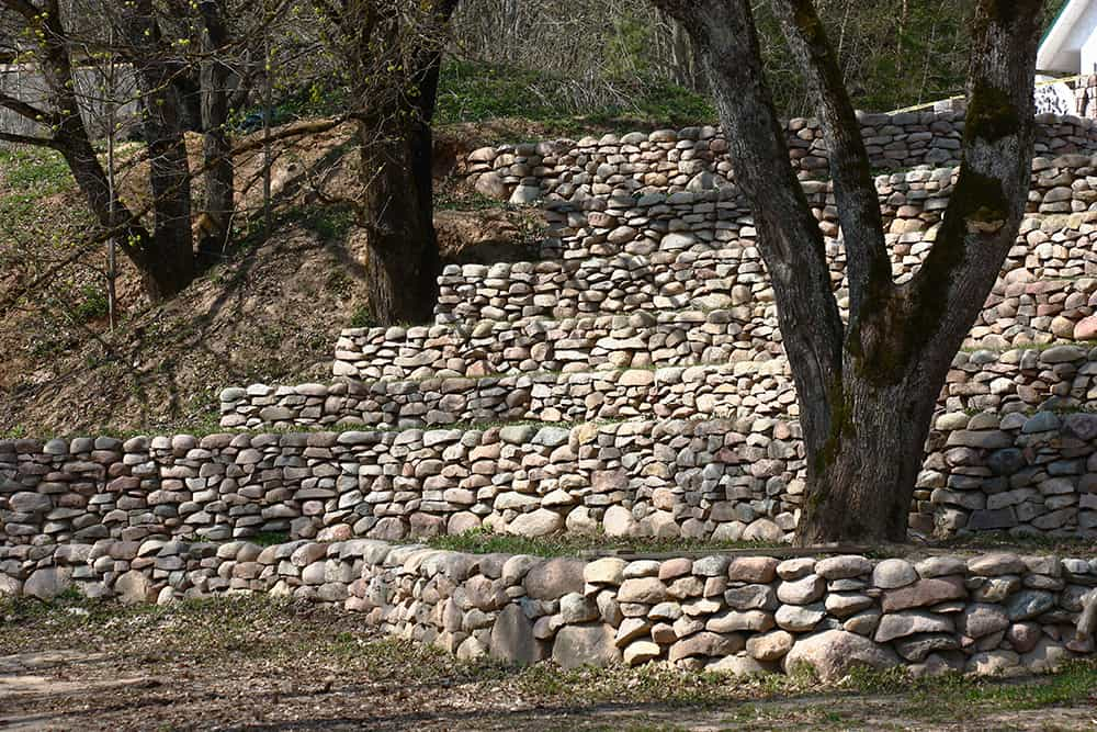 Terrace with stone built on a slope