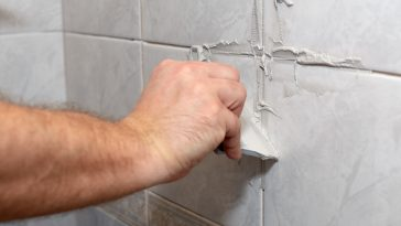 Do you grout between tile and wall?