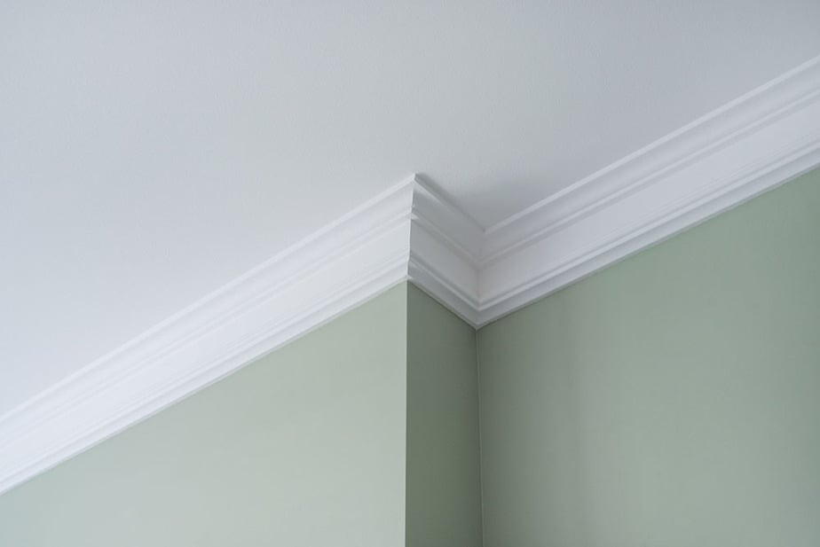 Covering drywall seams with trim