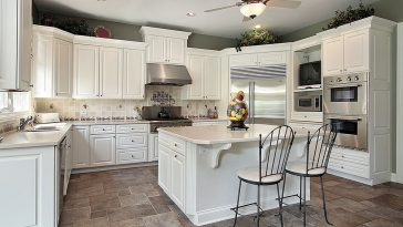 Do you grout between tile and cabinet?