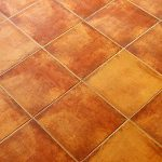 How long should you let tile set before grouting?