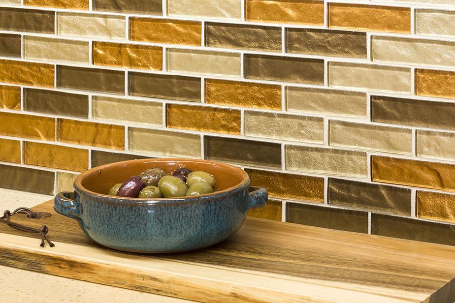 Plan the glass tile backsplash on the drywall before installation.