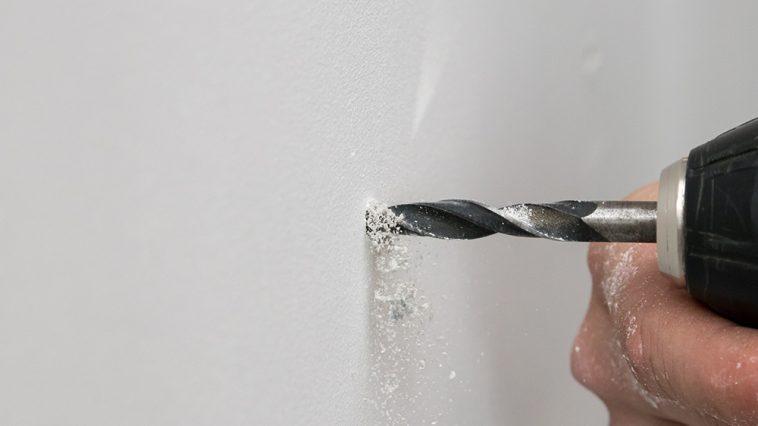 How to repair screw holes in drywall for reuse