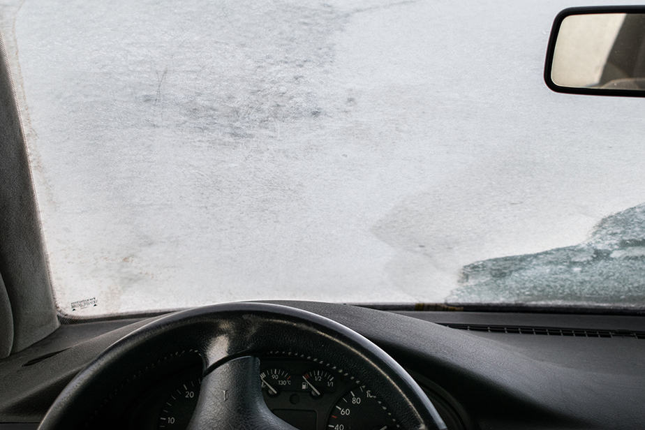 What causes the inside of your windshield to frost?