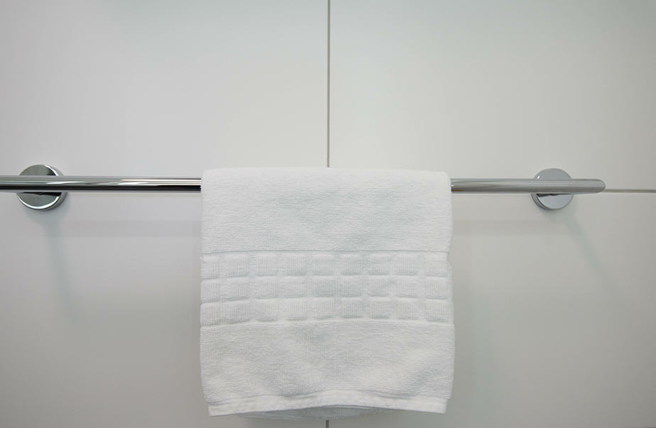 How to remove a towel bar with no visible screws
